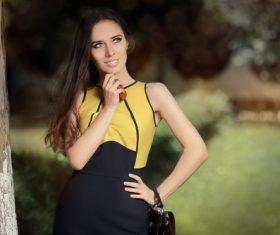 Elegant beautiful woman holding handbag Stock Photo