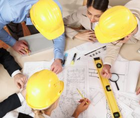 Engineer wearing yellow hard hat Stock Photo 01