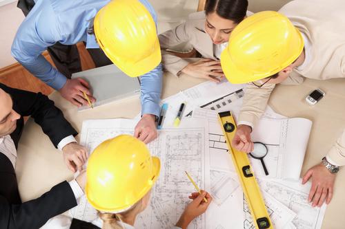 Engineer wearing yellow hard hat Stock Photo 01