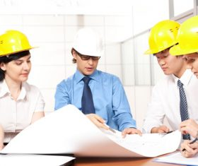Engineer wearing yellow hard hat Stock Photo 02