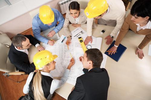 Engineer wearing yellow hard hat Stock Photo 03