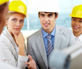 Engineer wearing yellow hard hat Stock Photo 04