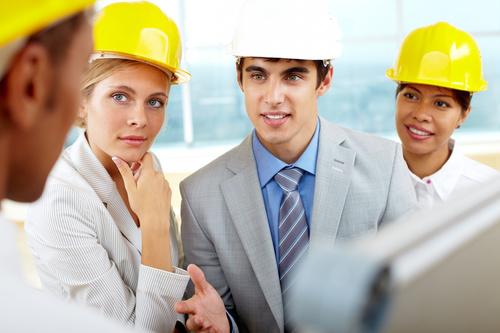 Engineer wearing yellow hard hat Stock Photo 04