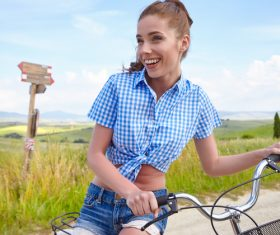Girl is posing on country road and bicycle Stock Photo 01