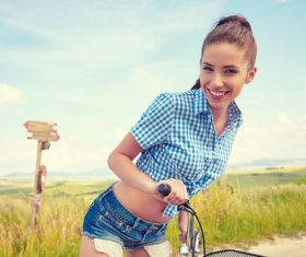 Girl is posing on country road and bicycle Stock Photo 02