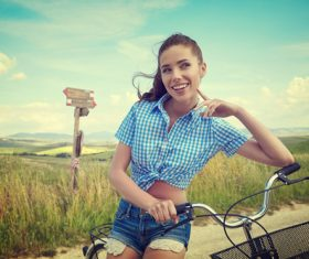 Girl is posing on country road and bicycle Stock Photo 03