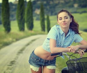 Girl is posing on country road and bicycle Stock Photo 04