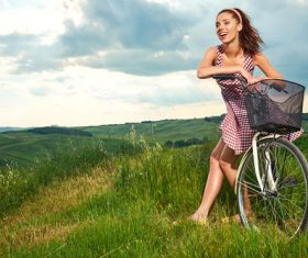 Girl pushing a bicycle to look at the scenery Stock Photo 01
