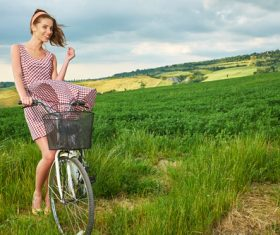 Girl pushing a bicycle to look at the scenery Stock Photo 02