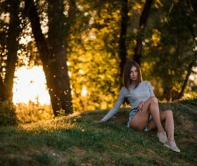 Girl sitting in the woods taking pictures Stock Photo