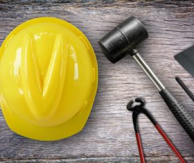 Hard hat and tools on the table Stock Photo