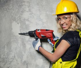 Holding drill female construction workers Stock Photo
