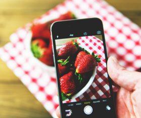 Iphone capturing fruit photo Stock Photo