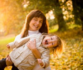 Little child and grandmother playing in the park Stock Photo