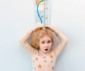 Little girl measuring height Stock Photo