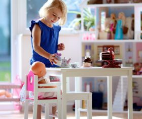 Little girl playing mini doll house at home Stock Photo 03