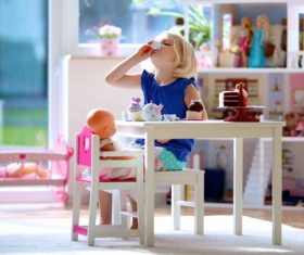 Little girl playing mini doll house at home Stock Photo 04