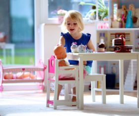 Little girl playing mini doll house at home Stock Photo 05