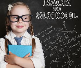 Little girl standing in front of the blackboard Stock Photo 01