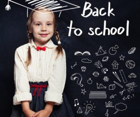 Little girl standing in front of the blackboard Stock Photo 03
