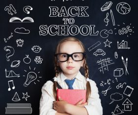 Little girl standing in front of the blackboard Stock Photo 05