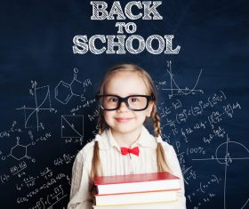 Little girl standing in front of the blackboard Stock Photo 08