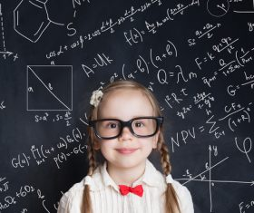 Little girl standing in front of the blackboard Stock Photo 09
