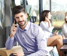 Man calling during business meeting break Stock Photo