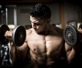 Man doing body building in the gym Stock Photo 02
