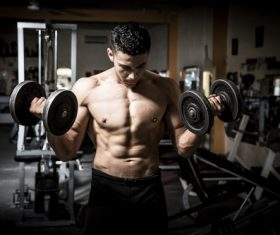 Man doing body building in the gym Stock Photo 03