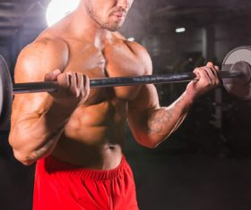 Man doing body building in the gym Stock Photo 04