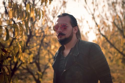 Man with sunglasses leaving beard Stock Photo