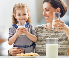 Mother and daughter drinking milk together Stock Photo
