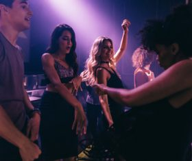 Nightclub dancing men and women Stock Photo