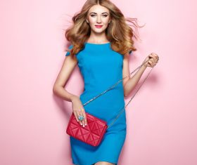 Pretty woman holding red satchel Stock Photo 01