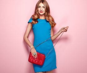 Pretty woman holding red satchel Stock Photo 02