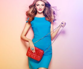 Pretty woman holding red satchel Stock Photo 03
