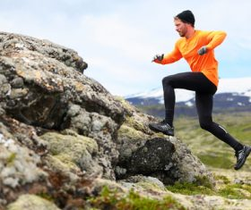 Running mountaineering man Stock Photo