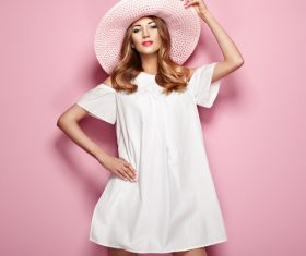 Slender body woman in white short skirt and sunhat Stock Photo