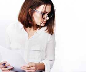 Stock Photo Businesswoman looking at market data files 01