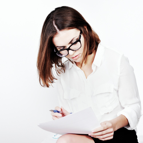Stock Photo Businesswoman looking at market data files 02