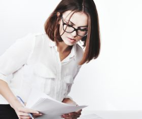 Stock Photo Businesswoman looking at market data files 03