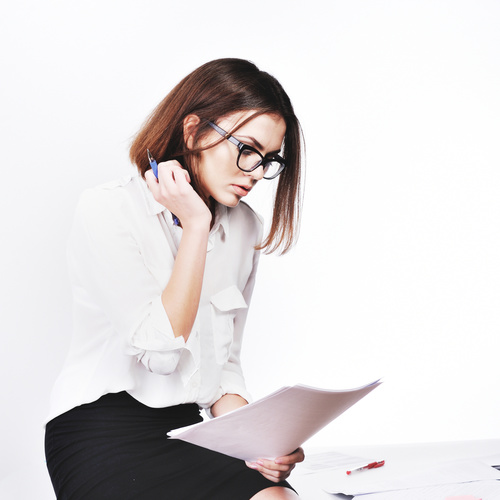 Stock Photo Businesswoman looking at market data files 04
