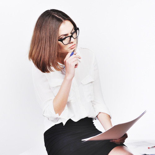 Stock Photo Businesswoman looking at market data files 05