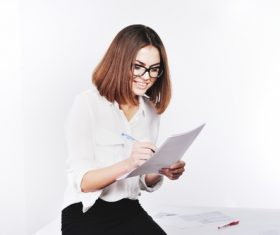 Stock Photo Businesswoman looking at market data files 06