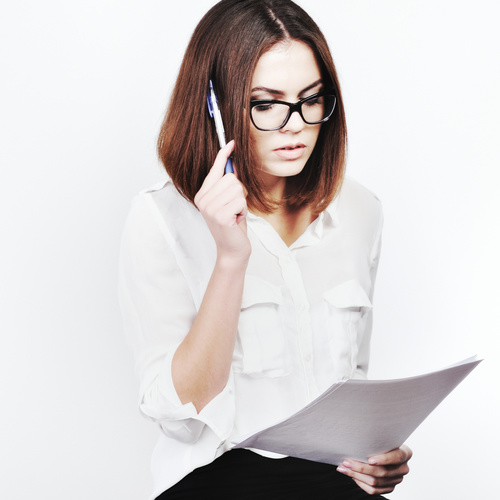 Stock Photo Businesswoman looking at market data files 07