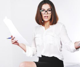 Stock Photo Businesswoman looking at market data files 09