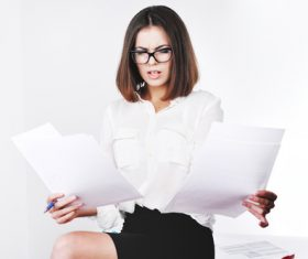 Stock Photo Businesswoman looking at market data files 10