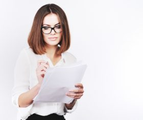 Stock Photo Businesswoman looking at market data files 11