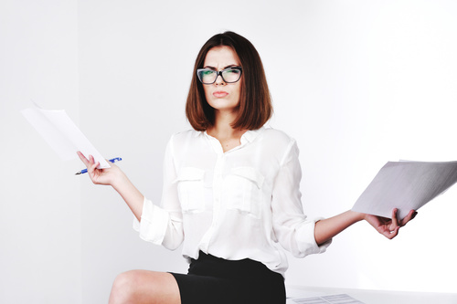 Stock Photo Businesswoman looking at market data files 12